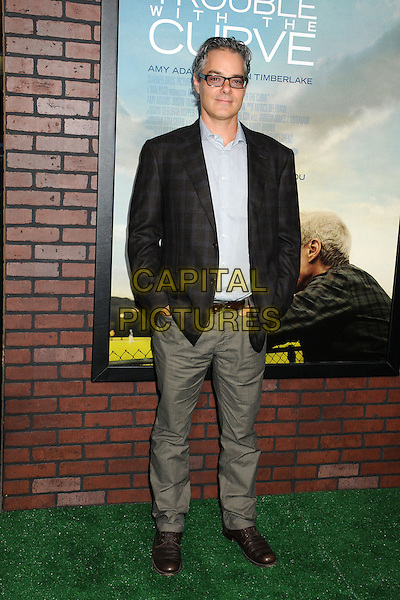 "Marco Beltrami.""Trouble With The Curve"" Los Angeles Premiere held at the Regency Village Theatre, Westwood, California, USA..September 19th, 2012.full length blue shirt suit glasses check  jacket hands in pockets black grey gray  .CAP/ADM/BP.©Byron Purvis/AdMedia/Capital Pictures."