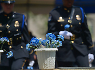 May 10, 2013  (Washington, DC) A pot of flowers sits atop a water fountain at the Washington Area Law Enforcement Memorial as police officers dedicate flowers to fallen officers.  (Photo by Don Baxter/Media Images International)