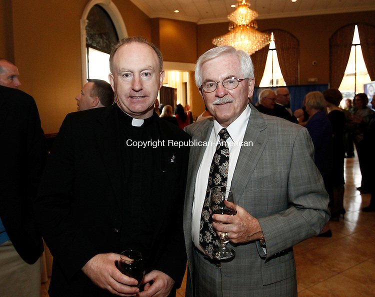 Waterbury, CT- 01 May 2014-050114CM15- SOCIAL MOMENTS---  Left to right, Seminarian John Cormack from the Archdiocese of Hartford and Michael Maunsell of Waterbury, during the Saint Mary School 125th Anniversary Gala at La Bella Vista at the Pontelandolfo Community Club in Waterbury on Thursday.   Christopher Massa Republican-American
