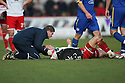 Chris Beardsley of Stevenage is treated by physio Paul Dando after being involved in an incident which led to Ben Chorley of Leyton Orient being sent off.- Stevenage v Leyton Orient- npower League 1 - Lamex Stadium, Stevenage - 2nd January 2012  .© Kevin Coleman 2012