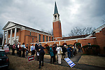 Voters line up outside of the Pulaski Heights Presbyterian Church shortly before the polls open on Super Tuesday, Feb 05, 2008 in Little Rock, Arkansas.