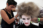 A model gets her hair and make-up done before the Thom Browne show at Mercedes-Benz Fashion Week in Manhattan, New York, on September 09, 2013.