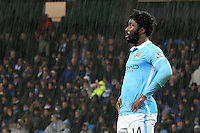 Wilfried Bony stands in the torrential rain during the Barclays Premier League Match between Manchester City and Swansea City played at the Etihad Stadium, Manchester on 12th December 2015