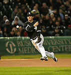 April 17, 2012: Chicago White Sox third baseman Brent Morel (22) throws to first base after fielding a soft ground ball by  Baltimore Orioles shortstop J.J. Hardy during a game at U.S. Cellular Field in Chicago, Illinois.  Hardy beat the throw for an infield single.  (Photo by Bob Campbell)