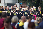 © Joel Goodman - 07973 332324 . 31 August 2013 . Rochdale , UK . People watch as The Rock Choir performs . The Rochdale Feel Good Festival . Photo credit : Joel Goodman