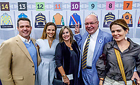 LOUISVILLE, KENTUCKY - MAY 03: Gunnevera majority owner Salomón Del Valle and his family pose for a photo in front of the post position board  after the Kentucky Derby Draw at Churchill Downs on May 2, 2017 in Louisville, Kentucky. (Photo by Jesse Caris/Eclipse Sportswire/Getty Images)