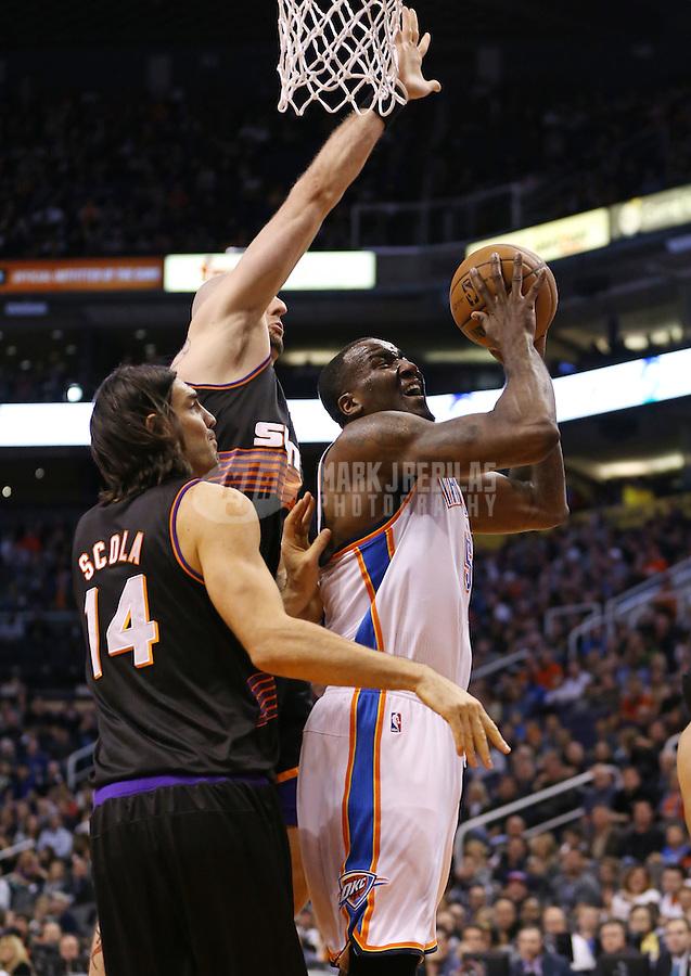 Feb. 10, 2013; Phoenix, AZ, USA: Oklahoma City Thunder center Kendrick Perkins against the Phoenix Suns at the US Airways Center. Mandatory Credit: Mark J. Rebilas-
