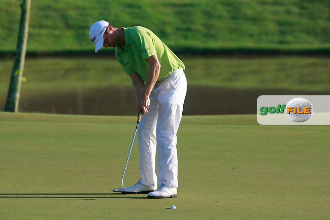 Michael Hoey (NIR) takes his putt on the 10th green during Thursday's Round 1 of the 2011 Iskandar Johor Open, Horizon Hills Golf Club, Johor, Malaysia, 15th November 2011 (Photo Eoin Clarke/www.golffile.ie)