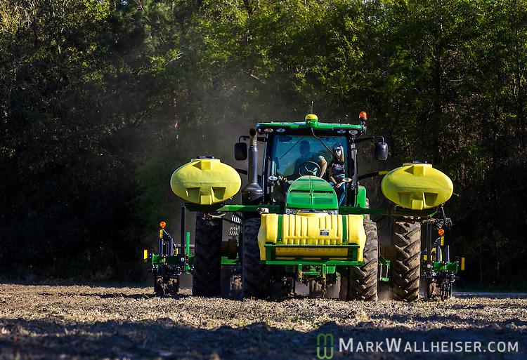 Randy Dowdy and his girlfriend Patsy Davis sprays herbicide near Valdosta, Ga. March 31, 2014.