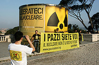 "Attivisti di Greenpeace incatenati davanti ad un bidone contenente altri attivisti, durante un'azione antinucleare sulla terrazza del Pincio, Roma, 25 maggio 2011..Greenpeace activists in chains hold a banner reading ""You are crazy. Nuclear is not our future"", past a tank bearing a banner reading ""Free us from the nuclear"" and containing others activists, during an antinuclear protest at Pincio's terrace, Rome, 25 may 2011. A referendum on nuclear power in Italy is scheduled for 12 and 13 june..UPDATE IMAGES PRESS/Riccardo De Luca"