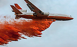 DC-10 Air Tanker drops retardant on Division S, below Pilot Peak, at Old Yosemite Road, to protect the Greeley Hill community after spot fire escaped the larger Rim Fire perimeter at the southwest corner the night before.