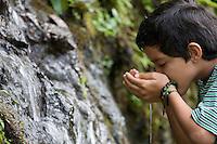 Marquito drinks from stream; Buenaventura Reserve; Ecuador, Prov. El Oro