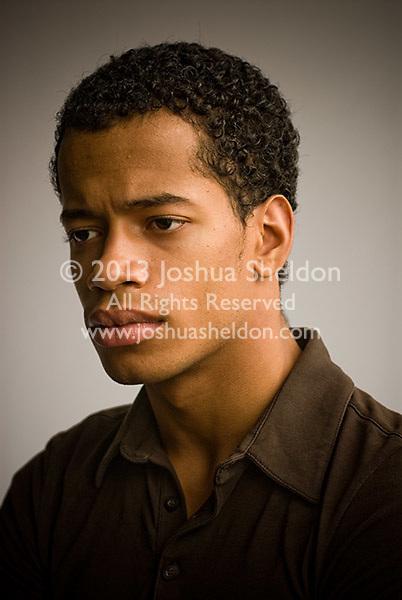 Studio portrait of young Hispanic man