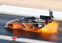 Oct 29, 2016; Las Vegas, NV, USA; NHRA funny car driver Jim Campbell suffers an engine fire during qualifying for the Toyota Nationals at The Strip at Las Vegas Motor Speedway. Campbell would be unhurt. Mandatory Credit: Mark J. Rebilas-USA TODAY Sports