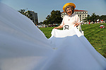 Sister Iria Miller holds the tail of a peace dove during a protest of thousands near capitol building as the Republican National Convention kicks off its first day of muted activities due to Hurricane Gustav in Saint Paul, Minnesota on September 1, 2008.