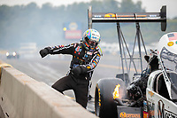 Sep 14, 2019; Mohnton, PA, USA; NHRA top fuel driver Austin Prock kicks the wall was he reacts after exploding an engine during qualifying for the Reading Nationals at Maple Grove Raceway. Mandatory Credit: Mark J. Rebilas-USA TODAY Sports