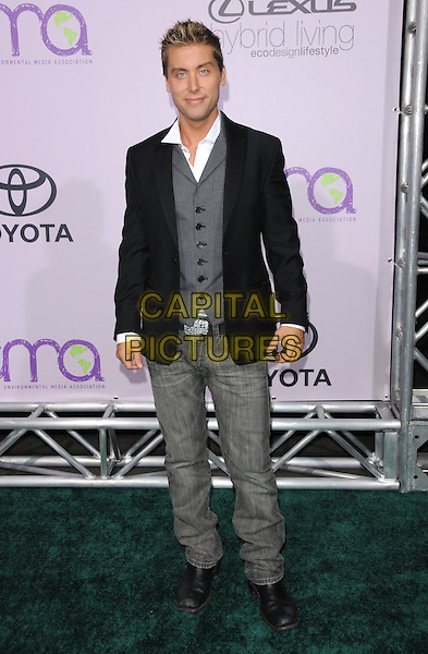 LANCE BASS .The 18th Annual Environmental Media Awards held at The Ebell Theatre in Los Angeles, California, USA..November 13th, 2008.full length jeans denim black suit jacket grey gray waistcoat .CAP/DVS.©Debbie VanStory/Capital Pictures.