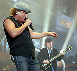 AC/DC singer Brian Johnson and guitarist Angus Young performs during the band's stop at the Toyota Center Sunday Dec. 14, 2008. (Dave Rossman for the Chronicle)