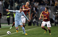 Calcio, Serie A: Roma vs Lazio. Roma, Stadio Olimpico, 8 aprile 2013..Lazio defender Stefan Radu, of Romania, left, is challenged by AS Roma midfielders Michael Bradley, of the United States, center, and Miralem Pjanic, of Bosnia, during the Italian serie A football match between A.S. Roma  and Lazio at Rome's Olympic stadium, 8 april 2013..UPDATE IMAGES PRESS/Isabella Bonotto