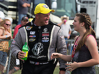 Apr. 28, 2013; Baytown, TX, USA: NHRA top fuel dragster driver Bob Vandergriff Jr celebrates with his daughter after winning the Spring Nationals at Royal Purple Raceway. Mandatory Credit: Mark J. Rebilas-