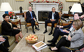 United States President Barack Obama makes a statement on the San Bernardino shootings in the Oval Office of the White House in Washington, D.C., U.S., on Thursday, December 3, 2015. With the President from left to right: US Attorney General Loretta Lynch, US Vice President Joe Biden and and FBI Director James Comey and other members of his national security team. Police say at least 14 people were killed, 17 hurt at a health department holiday party.<br /> Credit: Olivier Douliery / Pool via CNP