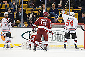 Steve Silva (Northeastern - 17) and Tyler McNeely (Northeastern - 94) celebrate Reid's goal. - The Northeastern University Huskies defeated the Harvard University Crimson 4-0 in their Beanpot opener on Monday, February 7, 2011, at TD Garden in Boston, Massachusetts.