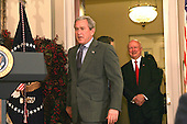 United States President George W. Bush, left, arrives to announce that Samuel Bodman, right, is his choice to be the US Secretary of the Department of Energy.  <br /> Credit: Dennis Brack / Pool via CNP