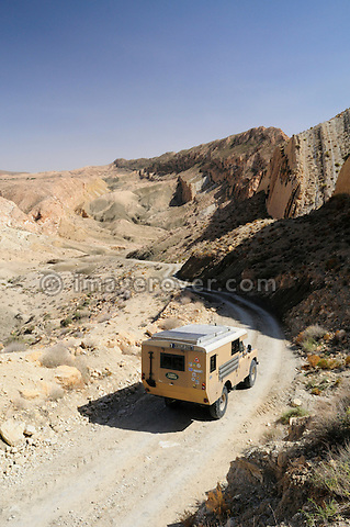 Africa, Tunisia, nr. Saket. Land Rover Ambulance descending into the famous narrow gorge near Saket. --- No releases available, but releases may not be needed for certain uses. Automotive trademarks are the property of the trademark holder, authorization may be needed for some uses.  --- Info: Image belongs to a series of photographs taken on a journey to southern Tunisia in North Africa in October 2010. The trip was undertaken by 10 people driving 5 historic Series Land Rover vehicles from the 1960's and 1970's. Most of the journey's time was spent in the Sahara desert, especially in the area around Douz, Tembaine, Ksar Ghilane on the eastern edge of the Grand Erg Oriental.