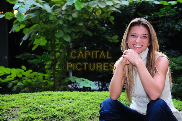 """MARGHERITA GRANBASSI.Photocall for """"Quelli che... il calcio"""" (Annozero), Rome, Italy..September 24th, 2008.half length jeans denim white top sitting .CAP/CAV.©Luca Cavallari/Capital Pictures."""