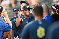 Closing pitcher Jose Moreno (26) of the Columbia Fireflies is greeted after a scoreless inning on his way to earning the save in a 3-2 win over the Augusta GreenJackets on Saturday, June 1, 2019, at Segra Park in Columbia, South Carolina. (Tom Priddy/Four Seam Images)