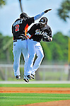 13 March 2012: Miami Marlins infielder Jose Reyes and Hanley Ramirez jump and bump prior to a Spring Training game against the Atlanta Braves at Roger Dean Stadium in Jupiter, Florida. The two teams battled to a 2-2 tie playing 10 innings of Grapefruit League action. Mandatory Credit: Ed Wolfstein Photo