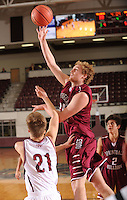 NWA Democrat-Gazette/ANDY SHUPE<br /> Kyler Mahar (center) of Springdale takes a shot over Luke Fox (left) of Tulsa (Okla.) Holland Hall Tuesday. Dec. 29, 2015, during the second half at Siloam Springs High School. Visit nwadg.com/photos to see more photographs from the game.