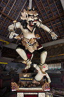Ogoh -Ogoh (demon)  sculpture of Kala Tumbang Wayang, abducting a child, West Ubud, Penestanan, Central Bali. Balinese New Year called Nyepi (around march according to lunar calendar),  is a silent day of meditation and spiritual purification. One day before exorcist rituals are held for purification and balance of polar powers of the universe, first at noon by a priest (exorcism called Caru or Tawur Agung) and later on after sunset in a popular, carneval-like procession of Ogoh-Ogoh, symbolizing bhuta kali (demon, bad spirits,bad habits),  so all the bad spirits leave the village and the island.  Loud, rhythmic music and special performances are part of the procession called Ngerupuk. Road crossings are major spots of exorcism and special ogoh-ogoh performance, since demons often like to dwell here. At Nyepi, the following day, there is 24 hours silence, no vehicle or people on the street, no light or fire, no working  all the bad spirits should think, the island is abandoned and leave the island. Day after Nyepi is a day of reconciliation  new year starts purified.