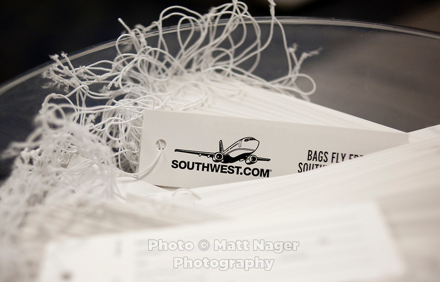 Baggage tags for Southwest Airlines at Love Field Airport in Dallas, Texas, Wednesday, October 27, 2010...PHOTO/ MATT NAGER