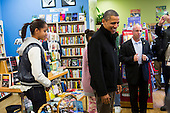 """United States President Barack Obama, center, and daughter Malia, left, shop at One More Page Books in Arlington, Virginia on Small Business Saturday, November 24, 2012..Credit: Kristoffer Tripplaar  / Pool via CNP..Pool Report 1: Motorcade left the South Lawn [of the White House] at 1:02 p.m. and arrived in Arlington, Virginia, at One More Page Books at 1:15 p.m. for an OTR (Off the Record) Small Business Saturday event with Sasha and Malia.  From the door of the small book shop, which the White House described as an """"independent, neighborhood bookstore,"""" POTUS (President of the United States) could be seen holding up his BlackBerry, apparently looking up a title, as he spoke with shop owner Eileen McGervey. """"Preparation,"""" the president said. """"That's how I shop.""""  Wearing a dark windbreaker against the blustery weather outside, POTUS handed off a stack of about 10 books to the clerk -- pool was too far away to read titles -- (will send in a later report if we get them) and then shook hands with several employees. He then began to wander through the business with his daughters as pool was escorted out.  """"We're doing Christmas shopping,"""" POTUS said to a question from the pool about the fiscal cliff. """"Happy Thanksgiving, folks.""""  POTUS emerged about 10 minutes later to shake hands for a few minutes with two small groups that formed outside the shop on the sidewalk."""
