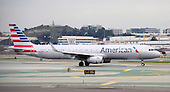 An American Airlines Boeing 757 aircraft rests on the tarmac at San Francisco International airport in San Francisco, California, awaiting its turn to take-off on Thursday, February 5, 2015.<br /> Credit: Ron Sachs / CNP