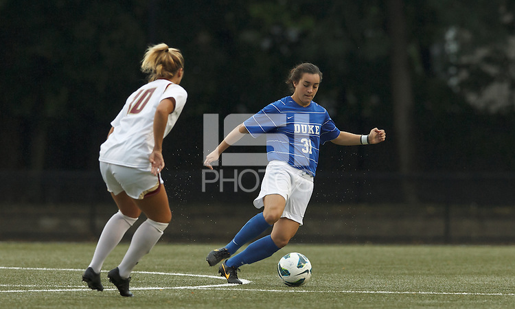 Duke University defender Christina Gibbons (31) dribbles as Boston College midfielder Gibby Wagner (10) closes.Boston College (white) defeated Duke University (blue/white), 4-1, at Newton Campus Field, on October 6, 2013.
