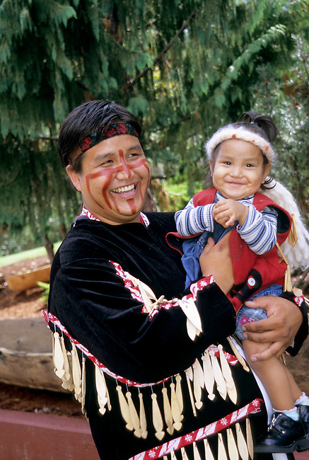 Native American family of Father and young daughter dressed in the traditional regalia of the Northwest Coast Cowichan tribe, Vancouver Island, BC, Canada