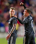 Real Salt Lake forward Brooks Lennon (12) points to Real Salt Lake midfielder Albert Rusnak (11) after Rusnak scored in the second half Saturday, April 21, 2018, during the Major League Soccer game at Rio Tiinto Stadium in Sandy, Utah. RSL beat the Colorado Rapids 3-0. (© 2018 Douglas C. Pizac)