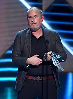 """LOS ANGELES - DECEMBER 6: """"Red Dead Redemption 2"""" (Rockstar Games) accepts the Best Narrative award onstage at the 2018 Game Awards at the Microsoft Theater on December 6, 2018 in Los Angeles, California. (Photo by Frank Micelotta/PictureGroup)"""