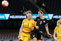 June 7, 2016: LAURA ALLEWAY (5) of Australia and ABBY ERCEG (5) of New Zealand jump for the ball during an international friendly match between the Australian Matildas and the New Zealand Football Ferns as part of the teams' preparation for the Rio Olympic Games at Etihad Stadium, Melbourne. Photo Sydney Low