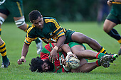 Simon Lemalu crashes to ground in Peni Buakuka's tackle.  Counties Manukau Premier Club Rugby game between Pukekohe and Waiuku played at Colin Lawrie Fields, Pukekohe, on Saturday July 3rd 2010. Pukekohe won 31 - 12 after leading 15 - 9 at halftime.