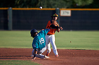 AZL Giants Orange second baseman Andrew Caraballo (1) throws to first base over Freuddy Batista (19) during an Arizona League game against the AZL Mariners on July 18, 2019 at the Giants Baseball Complex in Scottsdale, Arizona. The AZL Giants Orange defeated the AZL Mariners 7-4. (Zachary Lucy/Four Seam Images)