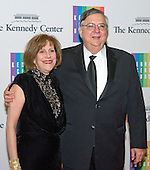 Charles B. Ortner and Betsy Jane Schwartz arrive for the formal Artist's Dinner honoring the recipients of the 2013 Kennedy Center Honors hosted by United States Secretary of State John F. Kerry at the U.S. Department of State in Washington, D.C. on Saturday, December 7, 2013. The 2013 honorees are: opera singer Martina Arroyo; pianist,  keyboardist, bandleader and composer Herbie Hancock; pianist, singer and songwriter Billy Joel; actress Shirley MacLaine; and musician and songwriter Carlos Santana.<br /> Credit: Ron Sachs / CNP