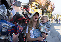 NWA Democrat-Gazette/CHARLIE KAIJO Natalie Northcutt of Prairie Grove holding Paxton Northcutt, 1, reacts as they visit with Transformers mascots, Friday, November 1, 2019 during the First Friday Toyland at the downtown square in Bentonville.<br /> <br /> The theme of this month's First Friday block party is Toyland. Kids had the opportunity to try out the latest toys.