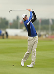 Chris Wood plays his approach to the first hole during the opening round of the ISPS Handa Wales Open 2013 at the Celtic Manor Resort<br /> <br /> 29.08.13<br /> <br /> ©Steve Pope-Sportingwales