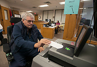 NWA Democrat-Gazette/J.T. WAMPLER Charles Whits of Fayetteville feeds his ballot into the ballot box while early voting Tuesday Nov. 27, 2018 at the Washington County Courthouse in Fayetteville. Early voting for Ward 1 and Ward 4 city council positions will continue through Monday Dec. 3.