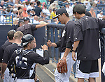 (L-R) John Ryan Murphy, Masahiro Tanaka (Yankees),  Shingo Horie,<br /> MARCH 25, 2015 - MLB :<br /> Pitcher Masahiro Tanaka of the New York Yankees bumps fists with catcher J. R. Murphy in the dugout during a spring training baseball game against the New York Mets at George M. Steinbrenner Field in Tampa, Florida, United States. (Photo by AFLO)