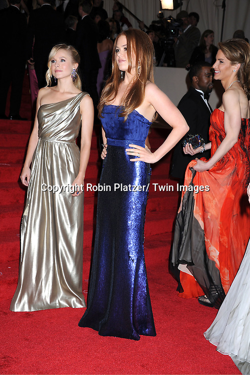 "Kristen Bell and isla Fisher arriving at The Costume Institute Gala Benefit celebriting ""Alexander McQueen: Savage Beauty"" at The Metropolitan Museum of Art in New York City on May 2, 2011."