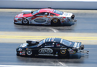 Apr. 14, 2012; Concord, NC, USA: NHRA pro stock driver Dave Connolly (near lane) races alongside Ronnie Humphrey during qualifying for the Four Wide Nationals at zMax Dragway. Mandatory Credit: Mark J. Rebilas-